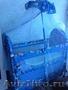 кроватка манеж, сине-голубого цвета на колесиках
